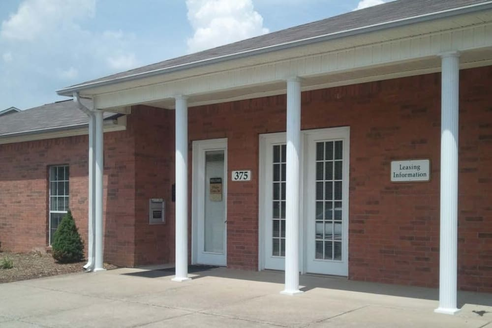 Rustic exterior of leasing office at Orchard Park Apartments in Clarksville, Tennessee
