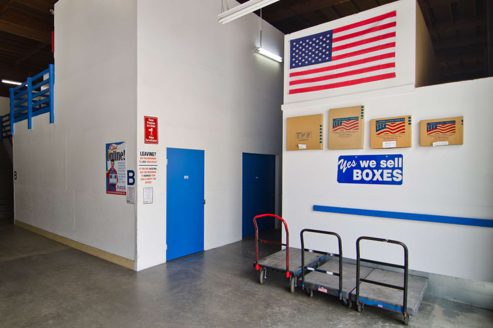 Entryway with carts and packing supplies available at A-American Self Storage in Santa Barbara, California
